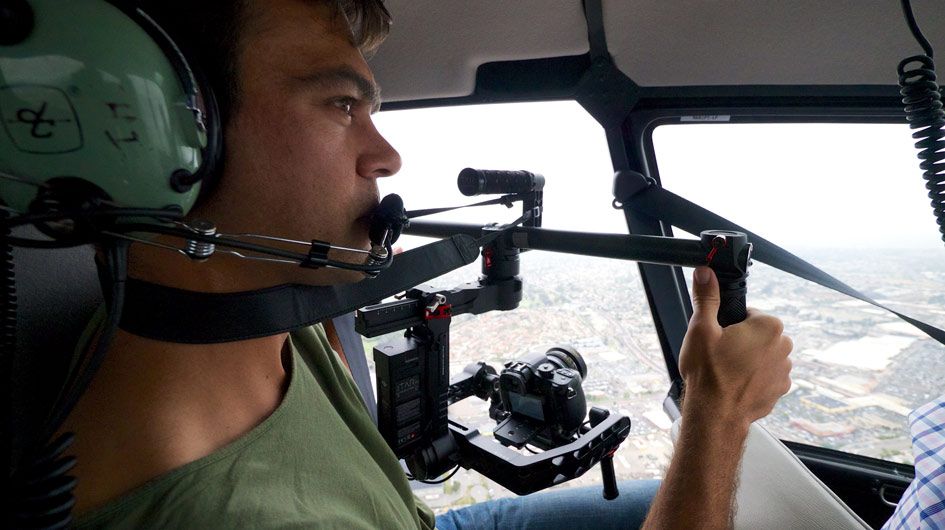 Video camera and remote controlled gimbal inside helicopter