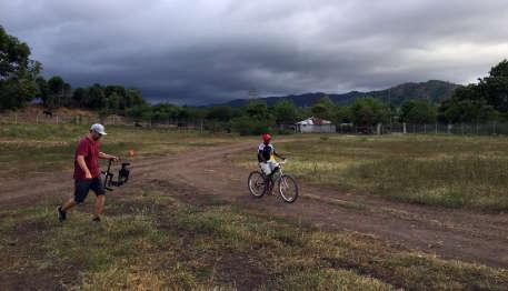 Haitian boy biking